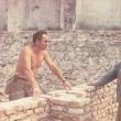 На снимката: Пастир Куличев като зидар. Строи църквата в Кричим!